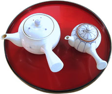 two tea pots and a tray
